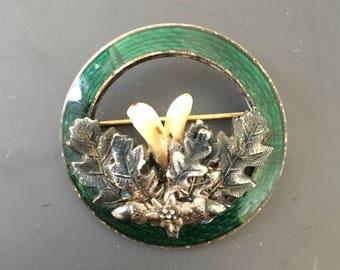 antique green enameled Bavarian Hunter's brooch with oak leaves and tooth