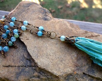 Carribean Blue Suri silk ribbon tassel long beaded necklace