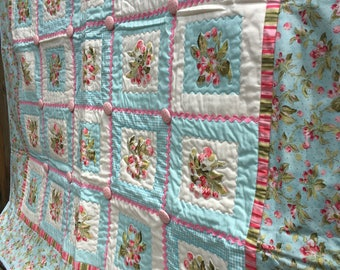 Old fashioned toddler bed quilt or throw