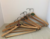 """6 Vintage Wooden Clothes Hangers with Advertising Logos 16 1/4"""" to 17"""" Wide"""