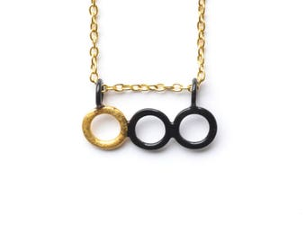 black three ring pendant with gold detail on gold plated chain, modern and minimalist pendant with hand made clasp, asymmetric jewellery