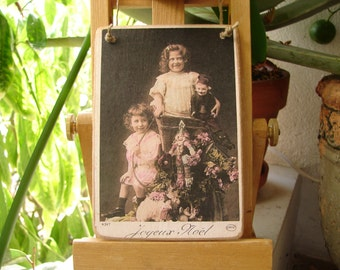 French Victorian style, Joyeaux Noel, Happy Christmas,little girls with toys, tinted photo image, small Holiday gift
