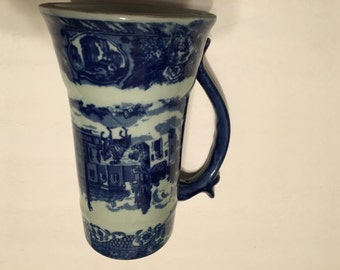 blue and white stein with maker's mark on bottom