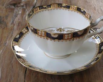 Crown W.L.L Antique china moustache tea cup and saucer set
