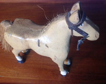 Vintage folk art carved wood horse with straw mane and tail painted