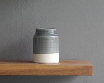 ready made vase. shorter size, slate glaze on white porcelain clay. bottle shaped vase by vitrified studio