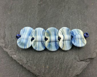 5 etched ivory/blue butterfly wing beads. Handmade Lampwork glass beads.