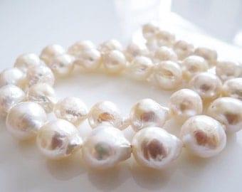 "Genuine Creamy White Freshwater Flameball Baroque Pearls 16"" strand"