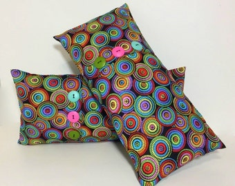 Insert included. Petite lumbar pillow. Button pleat accent pillow. Bright multi circle print. Throw pillow home decor accent