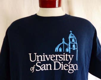 go USD Toreros vintage 90's University San Diego navy blue graphic t-shirt sky blue white church architecture logo crew neck tee oversize XL