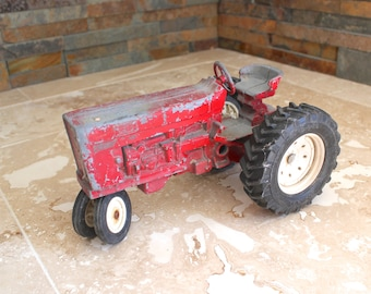 Red Ertl tractor, chippy red tractor, metal toy tractor, Ertl Co. Dyersville, Iowa, vintage toy tractor, International tractor, farm decor