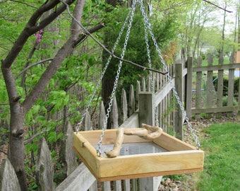 Hanging platform bird feeder with driftwood perch