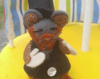 Miniature mouse in top hat, circus ring leader
