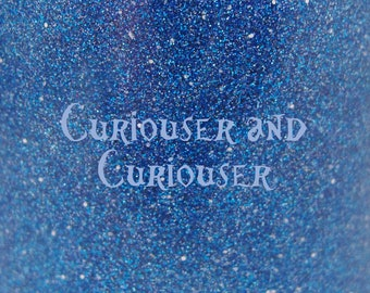 """Curiouser and Curiouser glitter nail polish 15 mL (.5 oz) from the """"Disney Girl"""" Collection (April)"""