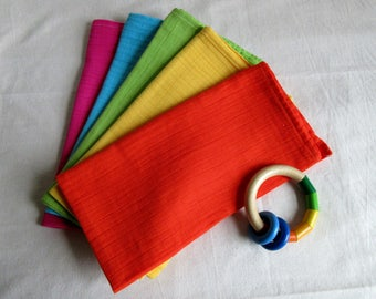 Handmade organic rainbow muslin squares colourful organic cotton burp cloth baby bib pink orange yellow green blue multipack baby shower gif