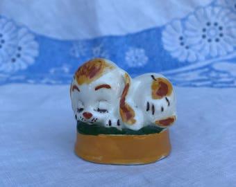 Kitschy Sleeping Puppy Dog Figurine