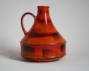 Dumler & Breiden orange fat lava vase made in the 1970s.