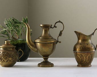 Set of 3 mini Moroccan brass pitchers and teapot
