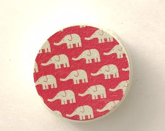 Drawer pull with cute pink and white elephant pattern