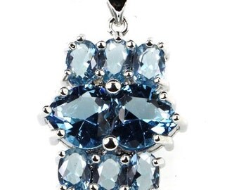 8.10ctw London Blue Topaz Heart and Oval Sterling Silver Pendant