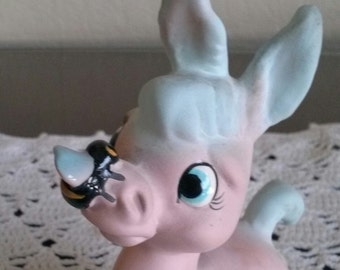 Pink Donkey Figure Blue Ears Tail and Hoofs Bee on Nose