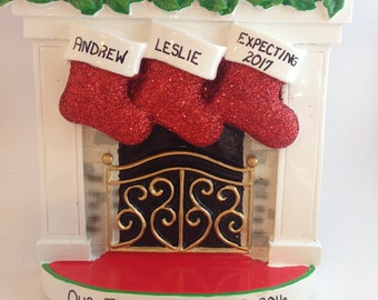Yuletide yournaments your name on every ornament by for Stocking clips for fireplace