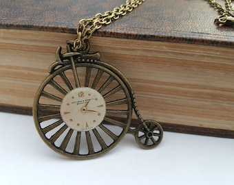 Vintage watch face on Penny Farthing steampunk necklace in antique bronze