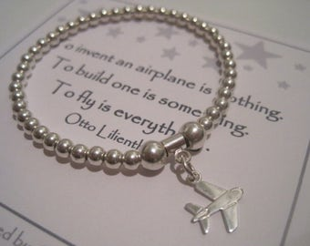 Sterling Silver Plane Charm Stretch Bead Bracelet - a perfect gift for an avid flyer or someone who likes to venture to exotic places!