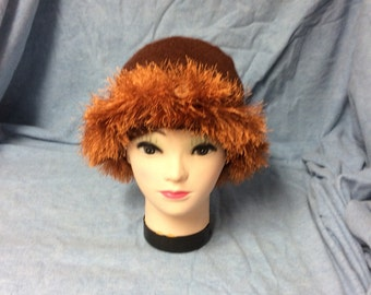 Handmade reddish brown womens hat with shaggy trim