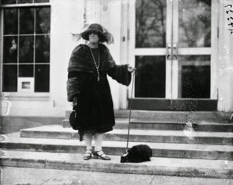 Woman visitor to the White House with her Pet Skunk, Early 1900's