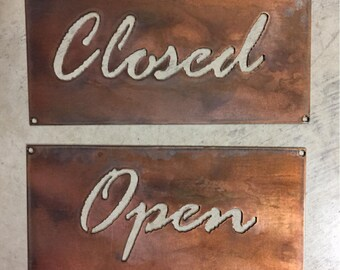 OPEN and CLOSED metal signs in rustic copper
