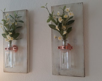 Distressed Wall Boards with Antique Glass Bottles and White Daisies Set of 2