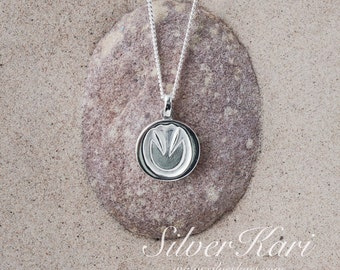 SilverHoven, a sterling silver necklace with a pendant of a barefoot hoof print