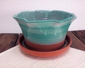 Small green ceramic plant...