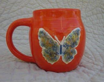 Butterfly in Orange pottery mug