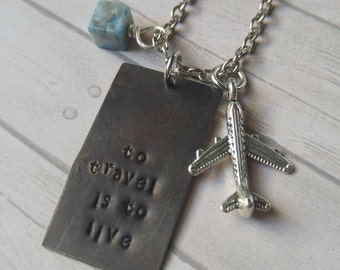To travel is to live stamped necklace with airplane charm and turquoise bead
