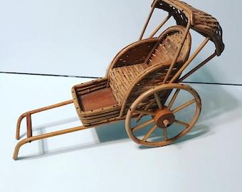 Vintage rattan and wicker rickshaw.