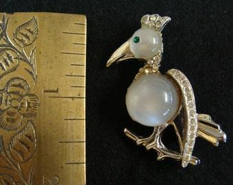 Silvertone and rhinestone jelly belly moonglow bird brooch