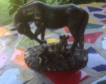 Vintage bronzed resin figurine featuring a mare and her foal