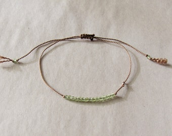 tiny PERIDOT beaded bracelet on a thin silk cord with tiny fine silver bead hand knotted gemstone layering August birthstone minimalist