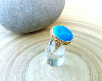 Turquoise silver ring, blue stone harakeke ring set in sterling silver & gold embelished with Maori Harakeke design.
