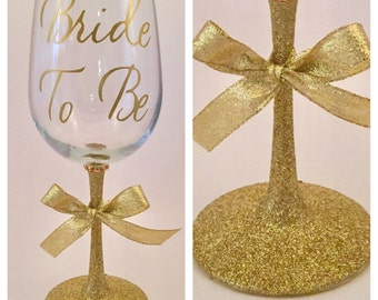 Gold Glitter Wine Glasses with black Ribbon