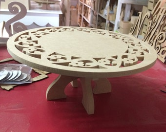 "Cake stand made of wood 12"" wide"