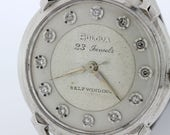 23 jewel, self-winding, diamond dial 14K Gold Bulova Wrist Watch