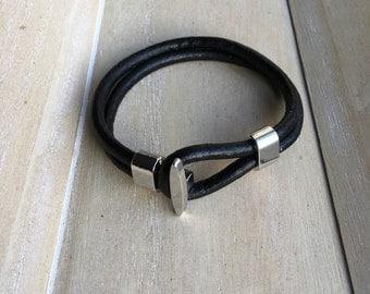 Black leather bracelet with loop and hook closure