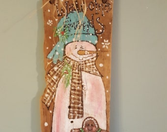 Hand painted snowman on very old barnwood