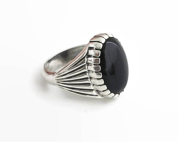 Sterling silver and black onyx signet ring, oval shaped cabochon onyx in ribbed bezel setting with ribbed sides, 13 grams, size 9 / S