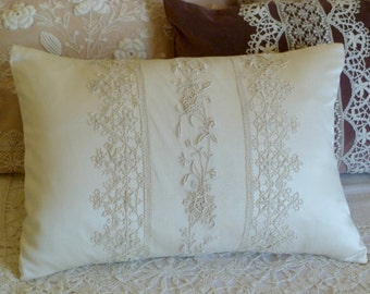 Handmade pillow of antique laces hand stitched to new cream charmeuse.