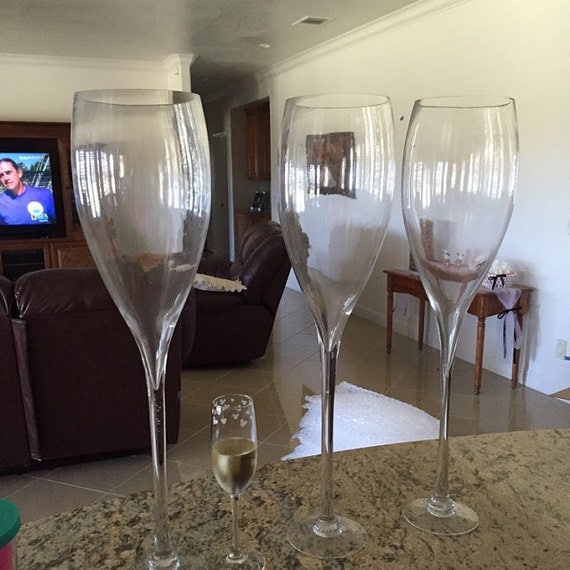 Tall champagne wine glass vase wedding centerpiece by