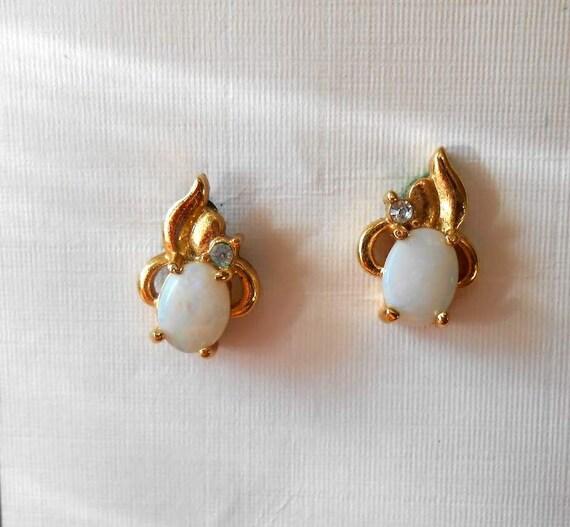 Small Opal Like Earrings In Goldtone Settings One Rhinestone Each Cat Like Design